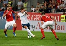 Roman Zobnin tegen Oostenrijkse spelers Aleksandar Dragovic en Peter Zulj stock foto's