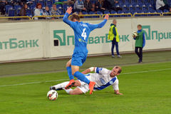 Roman Zozulya makes the tackle Stock Images