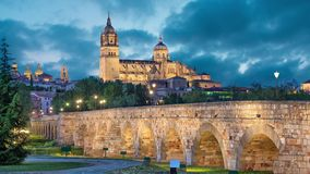 Romana Bridge with New Cathedral in Salamanca. Romana Bridge with New Cathedral at the background in the evening, Salamanca, Spain static image with animated sky stock video footage