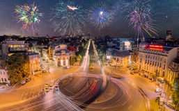 Romana Square in Bucharest, Romania with fireworks in the sky. Royalty Free Stock Photography