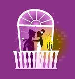Romance. Couple celebrating on tropical window facade with glass of wine and candle lights Royalty Free Stock Image