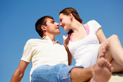 Romance. Photo of peaceful couple looking at each other with blue sky on background royalty free stock photo