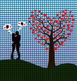 Romance. Couple kissing against heart shaped tree Royalty Free Stock Photos