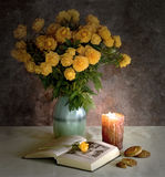 Romance. The open book, bouquet in a vase and a burning candle Stock Photo