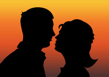 Romance. Abstract vector illustration of a silhouette of a man and a woman on sunset background Stock Image