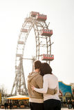 Romance in amusement park - young couple in love Royalty Free Stock Images