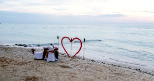 Romance on the beach. Playa Carmen on the Gulf of Mexico is the perfect setting for romance with a unique dinner setting by water's edge Royalty Free Stock Photo
