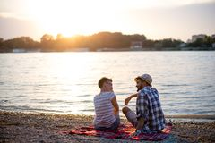 Romance on beach. Young couple having picnic Royalty Free Stock Photos