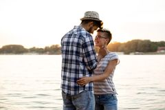 Romance on a beach in sunset. Romance on a beach, boy and girl are holding each other in sunset Royalty Free Stock Image