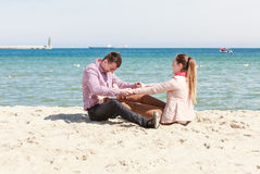 Happy couple having date on beach Stock Images