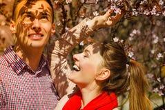 Happy couple having romantic date in park Royalty Free Stock Photos