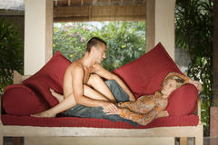 Romance Couple Girl Sleeping. Couple relaxing on sofa in a tropical location Stock Photography