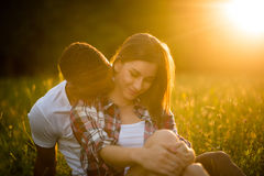 Romance - couple kissing at sunset Stock Photography