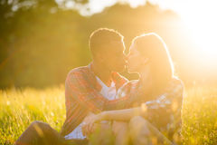 Romance - couple kissing at sunset Stock Images