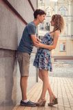 Lovers embraced and chatting in the old street of the city. royalty free stock photography