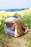 Romance in the dirt. A couple laying down in dirt kissing in a romantic setting Stock Images
