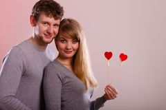 Girl with boy showing hearts. Stock Photos