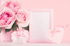 Romance festive mockup - delicate pastel pink flowers, gift box, heart with gentle ribbon and bow on white wooden table. Romance festive mockup - delicate stock images