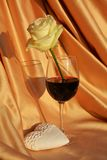 Romance, heart, rose and wine. Love image. White rose, red wine and floral white heart on sparkling golden background. Love and romantic concept Stock Images