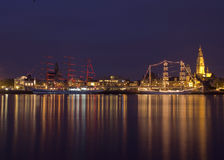 Romance in the Koekenstad. Antwerp Tall Ships Race, two three-master ships are moored at the river Scheldt, with the cityscape of Antwerp in the background Royalty Free Stock Photos