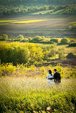 Romance in nature. Newly weds enjoy they first joint moment of love in beautiful nature Royalty Free Stock Image