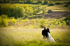 Romance in nature. Newly weds enjoy they first joint moment of love in beautiful nature Stock Photo