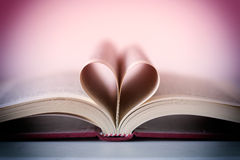 Romance novel heart shaped. Pages Stock Photos