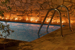 Romance at pool. Night shot of a villa water pool Royalty Free Stock Photography