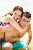 Romance. Portrait of happy couple on summer vacation looking at camera Stock Photos