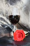 Romance, rose and red wine. Love image. Red rose and red wine on sparkling black background. Love and romantic concept Royalty Free Stock Photo