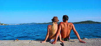 Romance by the sea. Loving couple near the sea in summer royalty free stock photos