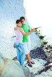 Romance on the seaside. Young couple having romentic minutes on the rocky coast, sunny morning Stock Image