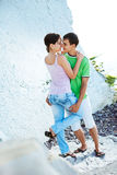 Romance on the seaside. Young couple having romentic minutes on the rocky coast, sunny morning Stock Photo