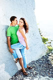 Romance on the seaside. Young couple having romentic minutes on the rocky coast, sunny morning Stock Images