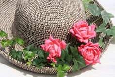 Romance strawhat with pink roses. Romance pinks roses and ivy with straw hat Stock Images