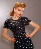 Romance. Styled Woman in Blue Retro Polka Dot Dress. Pin Up Style Stock Photo