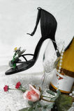Romance to Wine and Dine. High Heel shoe in wine glass with pearls