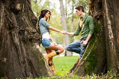 Romance Beside A Tree Trunk Royalty Free Stock Image