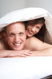 Romance under the sheets Stock Photos