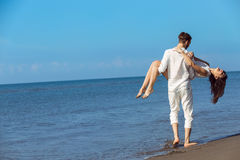 Romance on vacation: couple in love on the beach flirting Royalty Free Stock Image