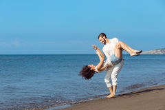 Romance on vacation: couple in love on the beach flirting Royalty Free Stock Photo