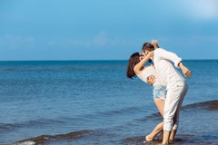 Romance on vacation: couple in love on the beach flirting Royalty Free Stock Images
