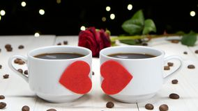 Romance in Valentine`s Day. Two cups of coffee for sweethearts. Romance in valentine day, two cups coffee for sweethearts, black hot coffee in white cups stock video footage