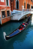 Venice. Romance in Venice, Italy: young couple on a gondola stock photo