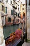 Romance of venice. Romance venezia gondola large red stool wall street in italy canal sea beautiful windows ancient buildings Royalty Free Stock Photos