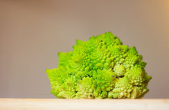 Romanesco broccoli on a Bamboo Cutting Board Stock Photos