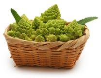 Romanesco broccoli. In a basket over white background Stock Photography