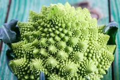 Romanesco broccoli close up. The fractal vegetable is known for it`s connection to the fibonacci sequence and the golden ratio. Fun food for any practical royalty free stock image