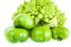 Romanesco broccoli, green tomatoes and red pepper. Cauliflower, tomatoes and red pepper for healthy eating and lifestyle Stock Photography
