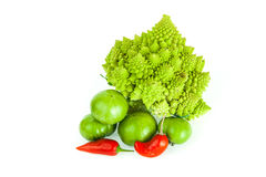 Romanesco broccoli, green tomatoes and red pepper. Cauliflower, tomatoes and red pepper for healthy eating and lifestyle Stock Images